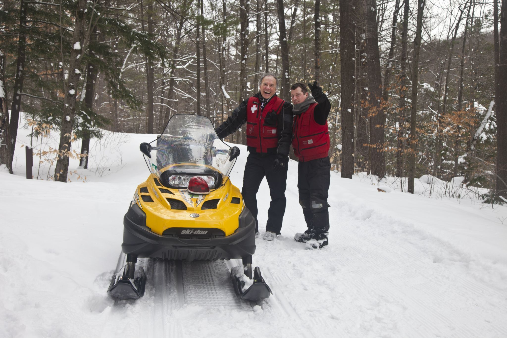Ski patrol on snow mobile