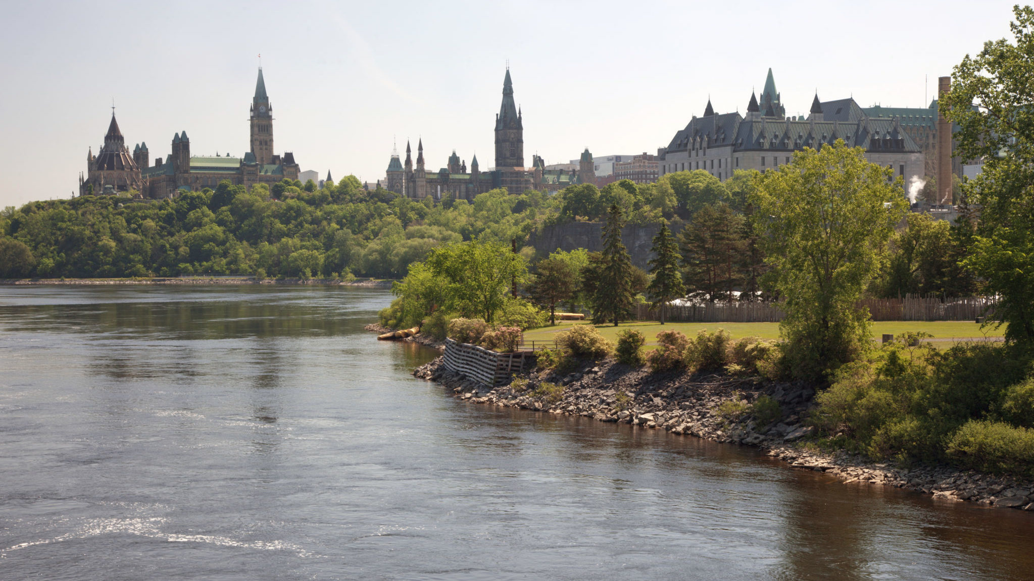 Victoria Island in the summer, with Parliament Hill and the Supreme Court of Canada in the background.