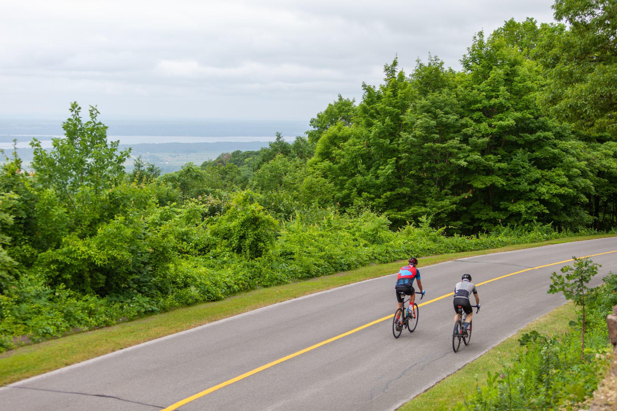 People biking on the car-free Gatineau Park parway.