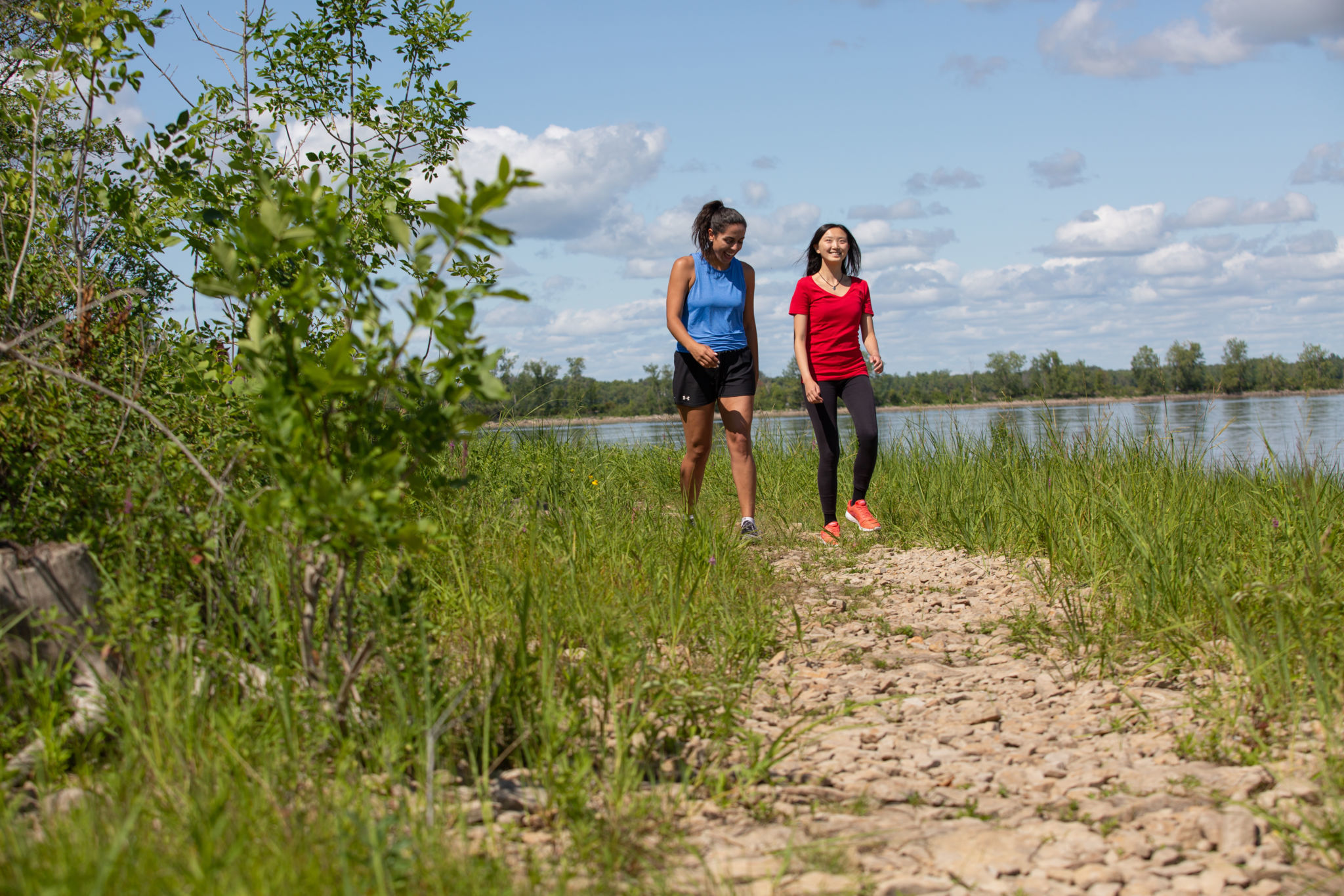 Two people walking on the Shoreline Trail.