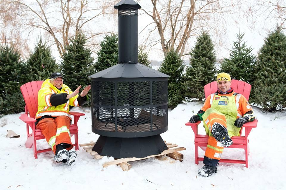 Groomer Pete (left) and Groomer Dave (right) by the firepit at the Nordic Village at Remic Rapids Park.