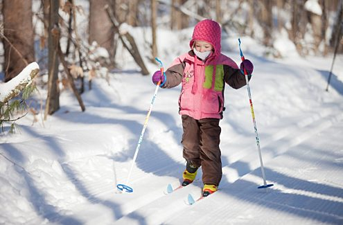 Young skier on classic cross-country tracks