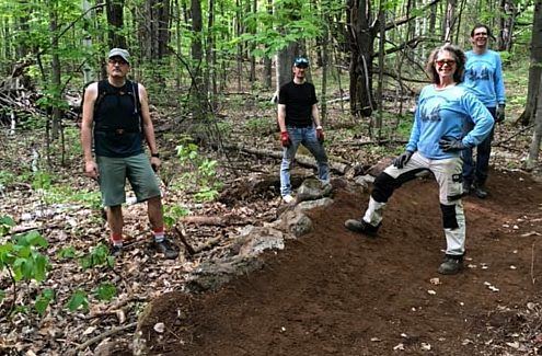 Volunteers at work in the Park (left to right: Hugo Richer, Alain Bellerive, Christine Galipeau and Marc Brulé).