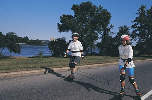 People in-line skating on a car-free parkway closed to motor vehicles during Bikedays.