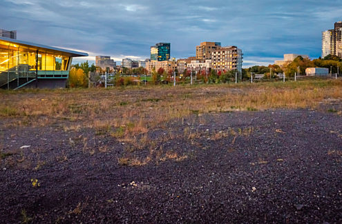 Photo of the current state of the Library Parcel development site at LeBreton Flats: a vacant 1.1-hectare parcel located at 665 Albert Street in Ottawa.
