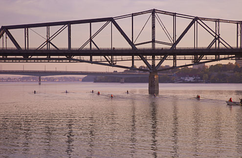 The Alexandra Bridge from the Ottawa River. In the background, the Macdonald-Cartier Bridge. Credit: NCC