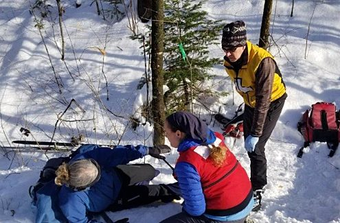 Patrol providing first aid in winter