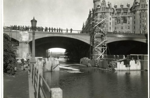 Onlookers observing the widening of the Plaza Bridge, with the Château Laurier in the background, August 25, 1938. Source: Library and Archives Canada (e999909164-u)