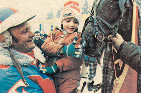 """A special visitor Justin Trudeau, age 7, helped by Renald  Filion, meets a Standardbred at the inaugural """"Trotting on the Rideau"""" event in 1979."""