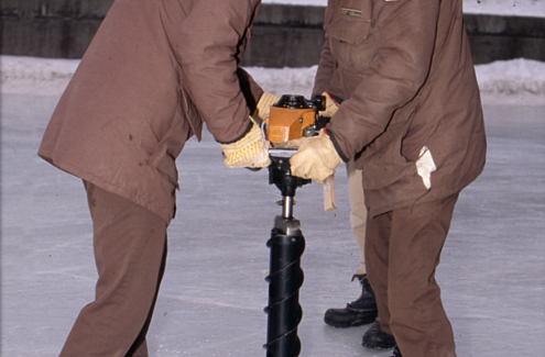 NCC ice experts in 1987 drill holes in the ice to measure the depth, flood the canal and smooth the skating surface.