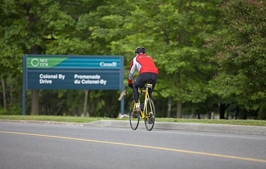 Cyclist on parkway open to active use