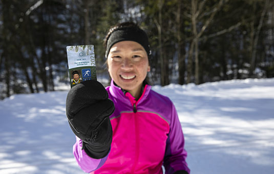 A user of Gatineau Park winter trails with her season pass