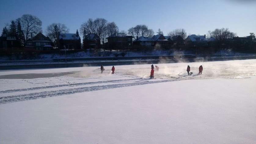 A team blowing snow on the skateway
